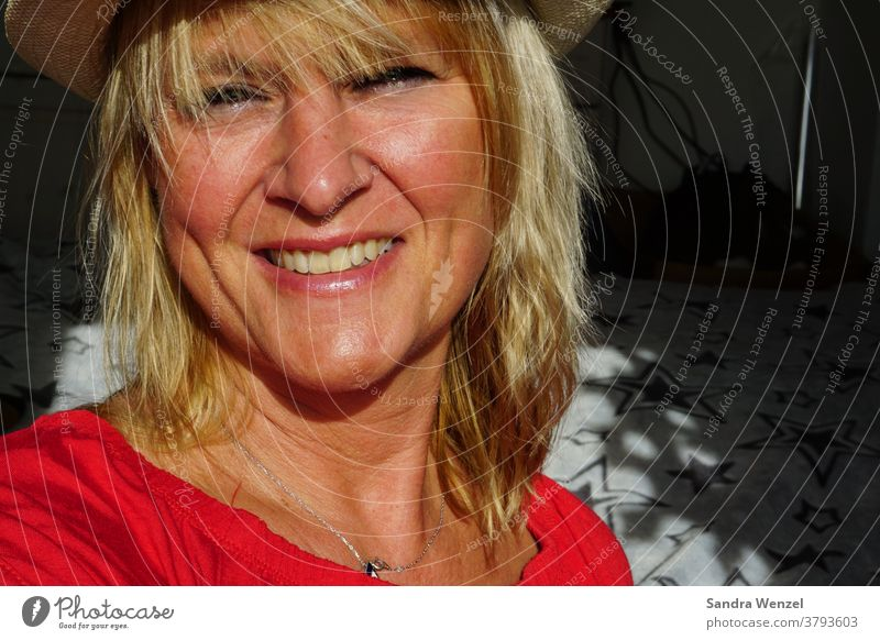 laughing woman with hat in sunlight Sun Woman Hat Blonde Sunlight Laughter Teeth