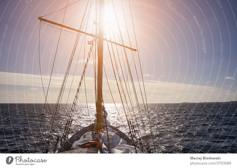 Sea sailing against the sunset. ship adventure travel sport water cruise freedom wave sea lifestyle schooner horizon boat wind ocean mast transport view