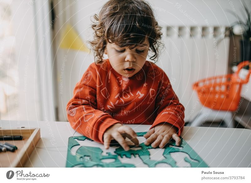 Child playing at home Letters (alphabet) Latin alphabet Characters Black Language Capital letter Colour photo Typography Word Communicate Children's game