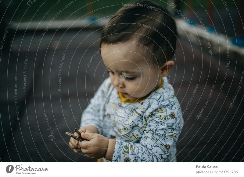 Toddler playing at playground Playing Playground 1 - 3 years Child Infancy Human being Exterior shot Colour photo Day Joy outdoors Nature Autumn Authentic