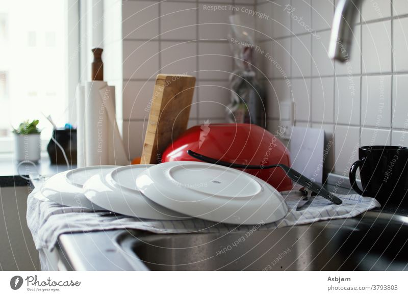 Clean dishes on counter Kitchen dishes stacked clean Do the dishes Household Cleaning Housekeeping messy real Authentic Kitchen sink Close-up