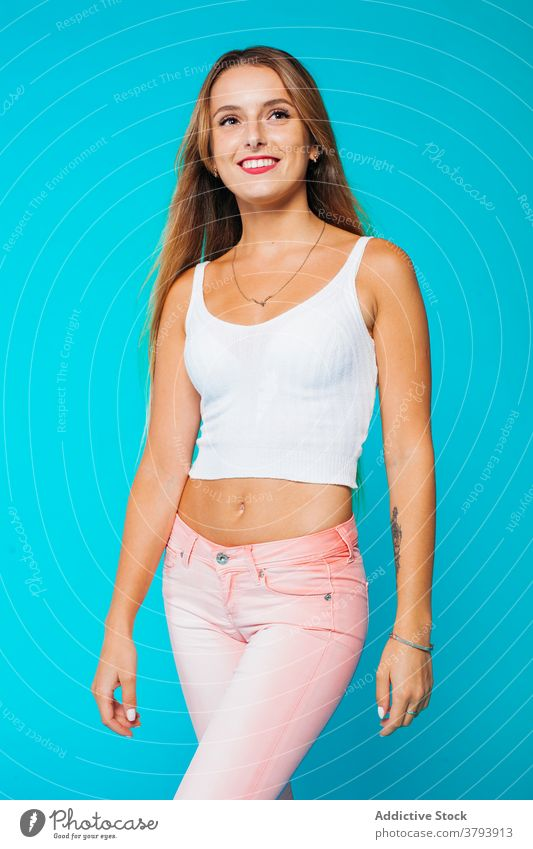 Slim young woman in skinny outfit fashion style jeans tank top casual slim wear cloth apparel garment modern millennial teenage adolescent confident colorful
