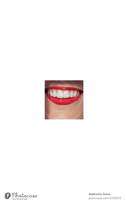 Smiling woman with red lips smile cosmetic beauty makeup lipstick hole visage mouth female happy cheerful bright positive fashion color colorful glamour delight