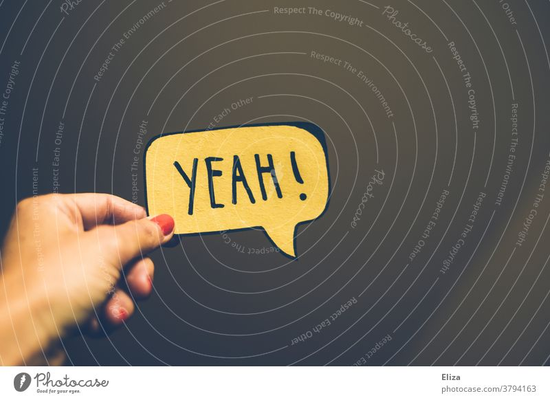Speech bubble with YEAH! written on it yeah Joy Yes Approval Success Word authored Communicate Positive Good Yellow Well done laud Optimism Emotions