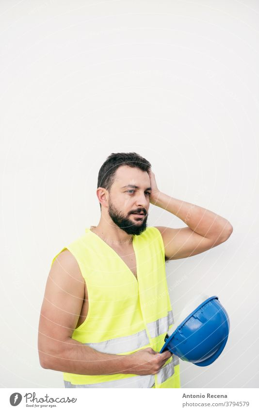 tired construction site builder with headache removes helmet man worker portrait arab middle eastern professional hardhat security isolated white background
