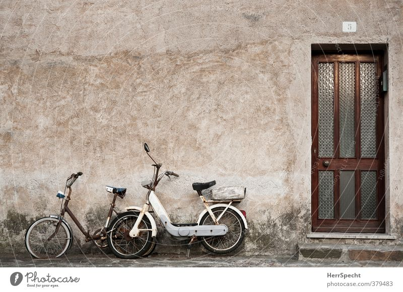 Rusting together Italy Village Small Town Old town House (Residential Structure) Building Wall (barrier) Wall (building) Facade Door Vehicle Motorcycle Bicycle