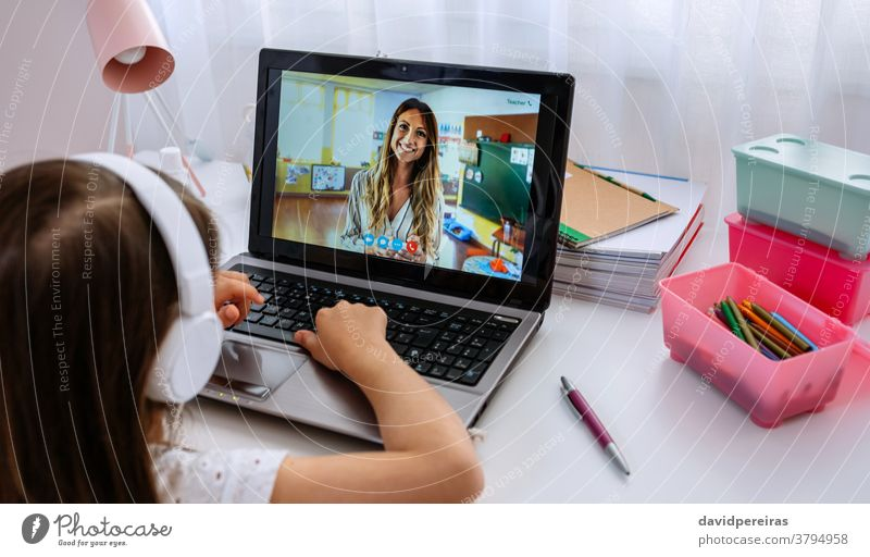 Laptop with teacher teaching class via videoconference online classes screen video call laptop social distancing home schooling girl covid-19 digital wisdom
