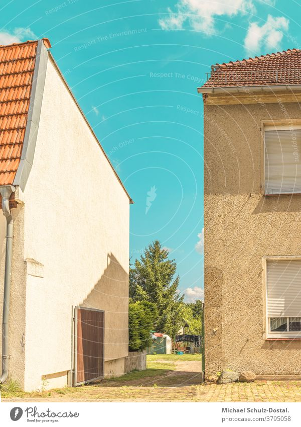 Passage between small town houses in summer urban Town city Flat (apartment) House (Residential Structure) graphically Colour shape surface minimal Geometry