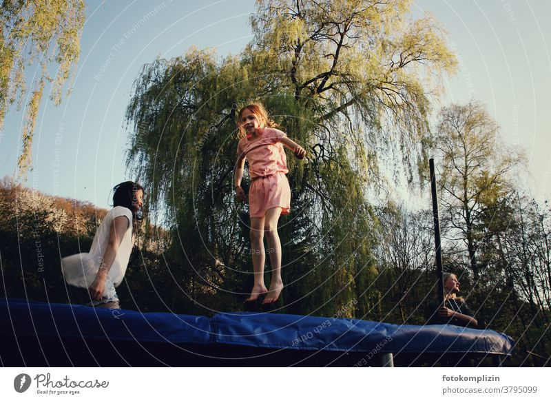 two bouncing girls on trampoline Girl Trampoline Funsport Jump jumping Playing Acrobatics activity Movement children vivacious feel oneself Mobility