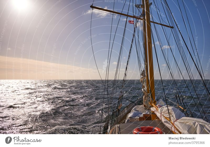Sailing old schooner at sunset, travel and adventure concept, sailing ship water cruise freedom wave sea lifestyle horizon boat wind ocean mast transport view
