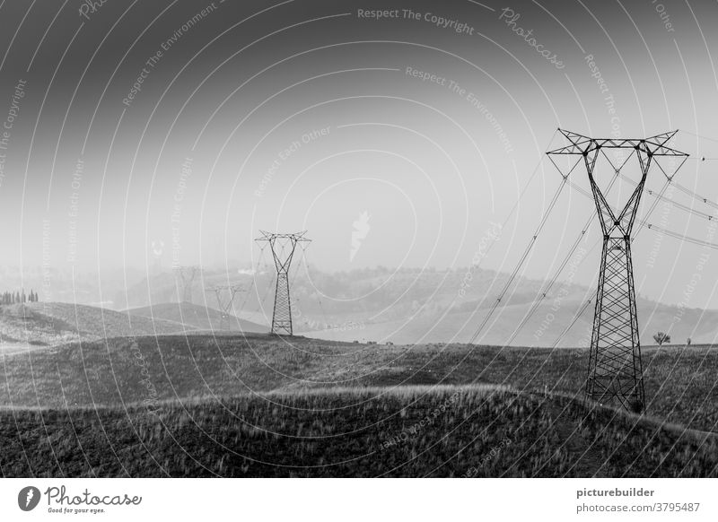 Power poles in the landscape Tuscany Italy Sky Hill stream power line Haze Landscape fields wide Deserted Exterior shot Day Beautiful weather Copy Space top