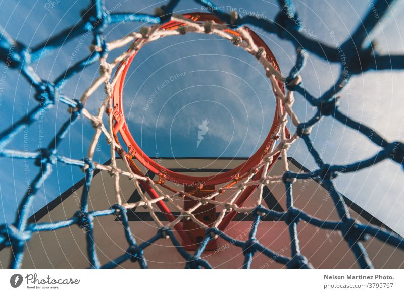 View from below of a basketball hoop. Abstract shot of a basketball net. blue Basketball Sports Net Playing Sky Exterior shot Ball sports Basketball basket Park