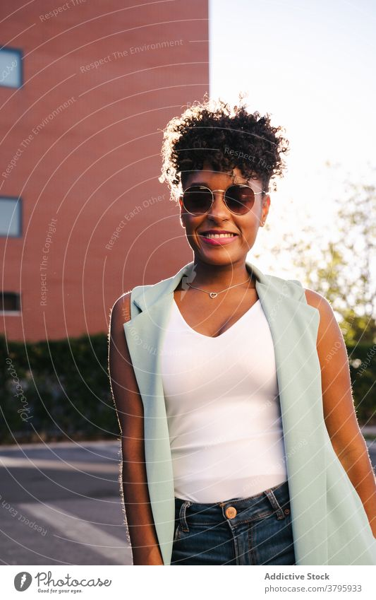 Happy ethnic woman in trendy outfit and sunglasses style fashion urban happy summer afro smile cheerful young female african american black positive casual