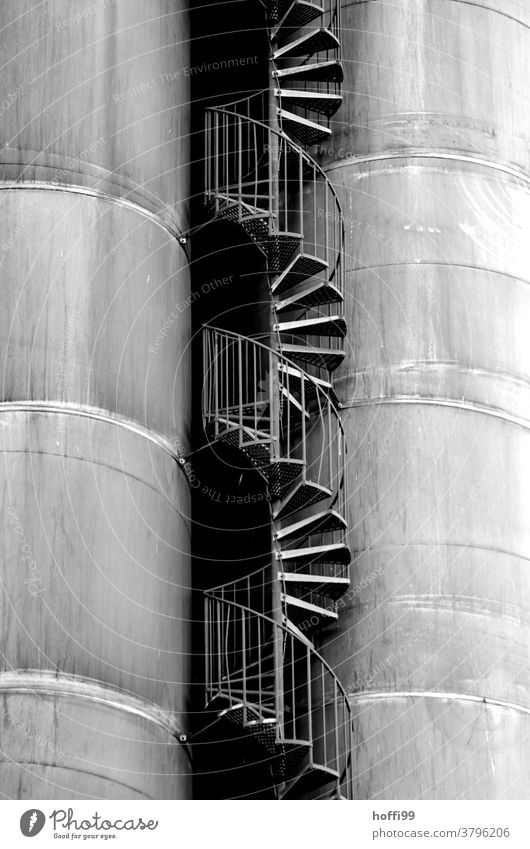 Stairs between the tanks Winding staircase Industrial plant Curve Industry Storage shed Gasometer Harbour Energy industry Silo Banister Gas tank Oil tank Facade