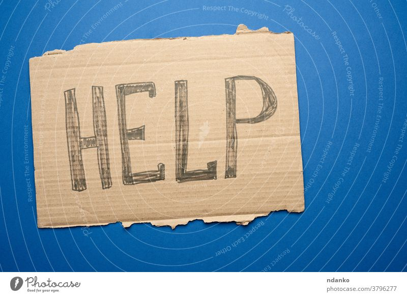 piece of cardboard with the inscription help, mutual assistance concept crisis homeless human information message one paper sign support symbol text torn word