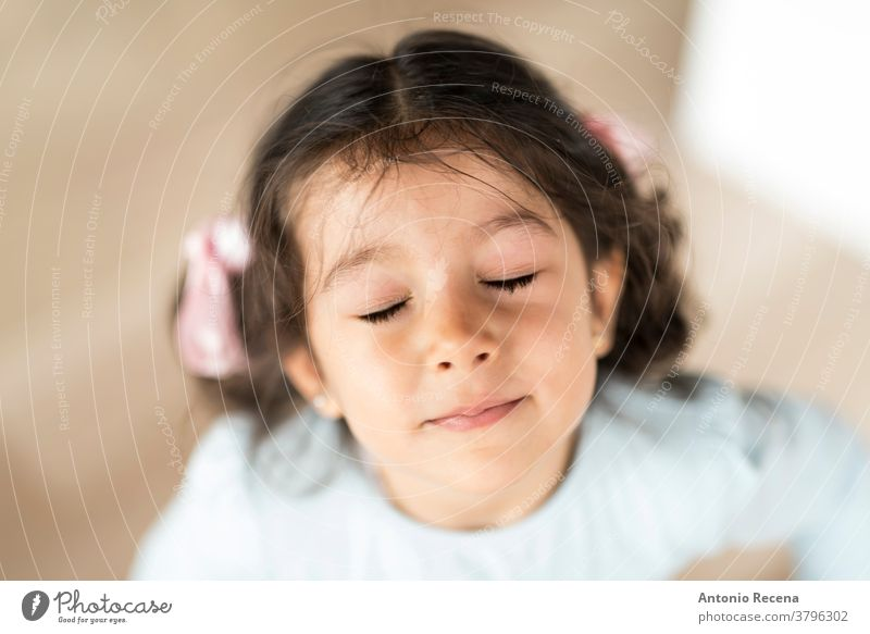 Little pretty girl portrait looking at camera with closed eyes three years old 3 years girls people illusion 3s face real people lifestyles child expression