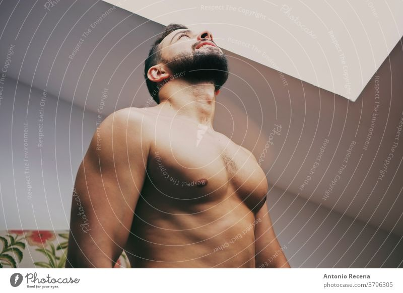 34 years old man looking window strong light torso looking up shirtless skylight men 30s male adult lifestyle person people bearded real people macho spanish