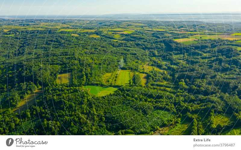 Aerial view of over green landscape Above Across Arable Bush Canopy Country Cultivated Cultivation Deciduous Drone Ecosystem Environment Farmland Field Flora