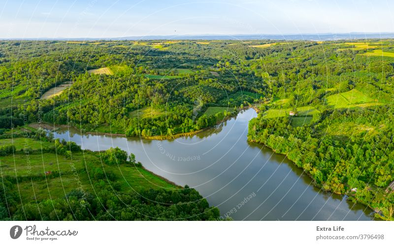 Above scene of landscape over lake with forest around, tree canopies Aerial Bush Canopy Coast Coastline Crown Deciduous Ecosystem Environment Farmland Field
