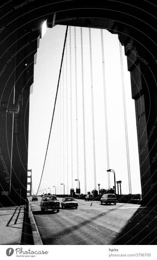 Golden Gate Transport Traffic infrastructure Light Black & white photo Golden Gate Bridge lines San Francisco USA