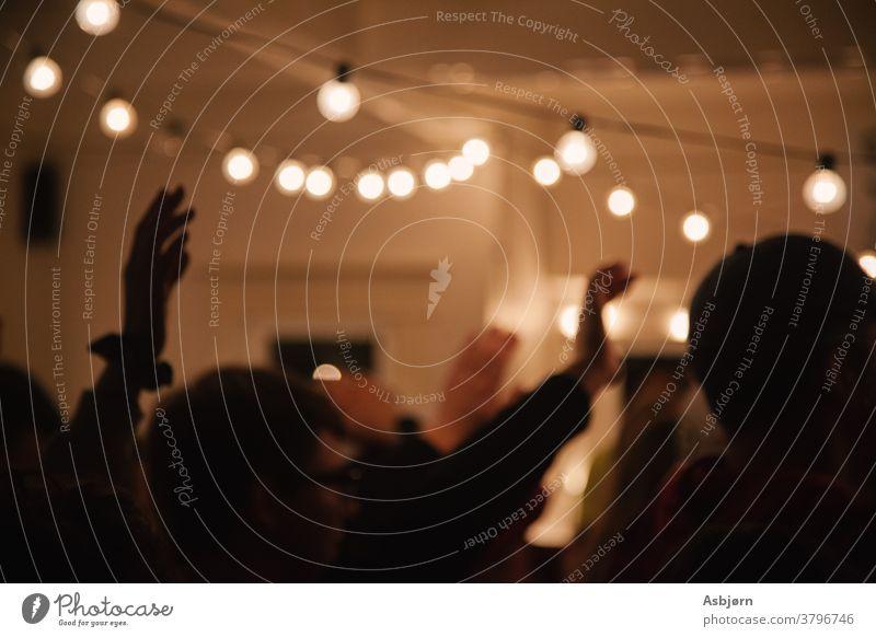 People with raised hands worship church intimate worshipping dark lightbulbs jesus music Religion and faith Light Christianity Jesus Christ Church