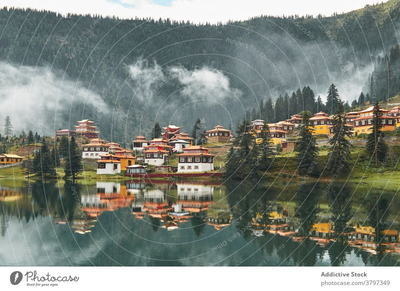 Traditional oriental temples on shore of lake buddhism heritage shrine highland buddhist water worship quiet ancient environment location tree historic attract