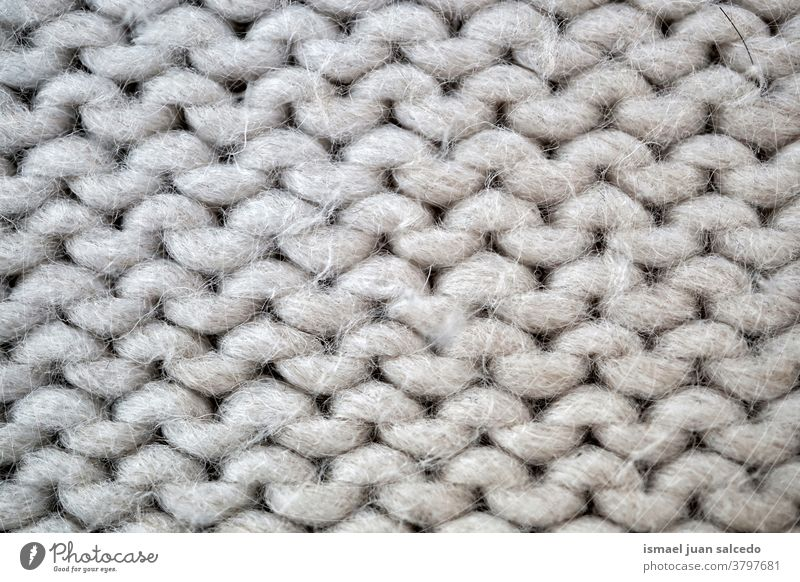 white wool, cloth handmade thread gray fabric textured abstract background pattern material industry textile design detail macro knitting clothing