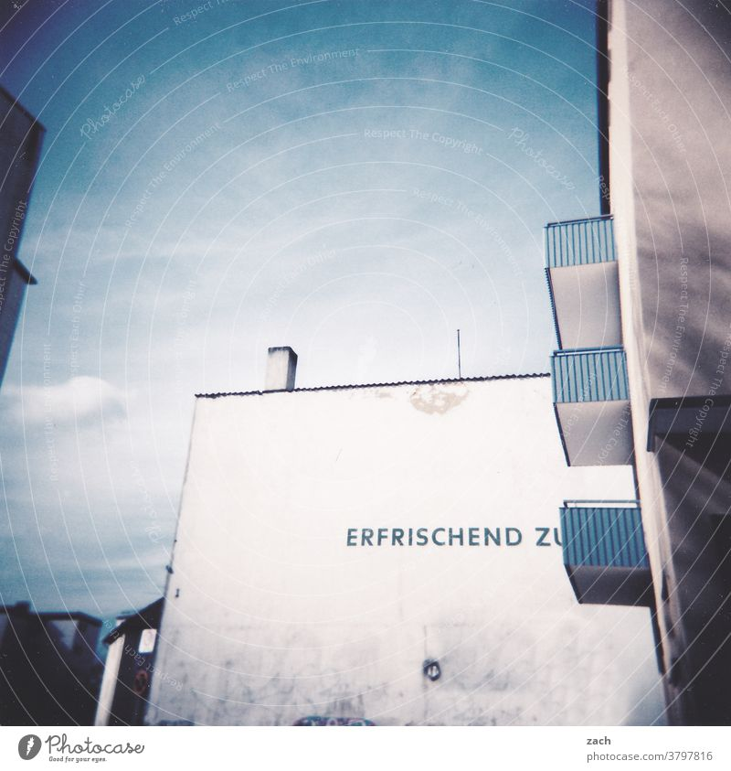 refreshingly Deserted Fresh Refreshment White Blue Sharp-edged Old Living or residing Characters Sign Balcony Wall (building) Wall (barrier) Kassel Town