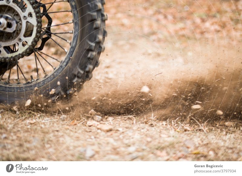 Motocross endurance wheel closeup motor extreme motocross dirt motorcycle competition racer rider sport power motorbike terrain speed offroad rally one woods