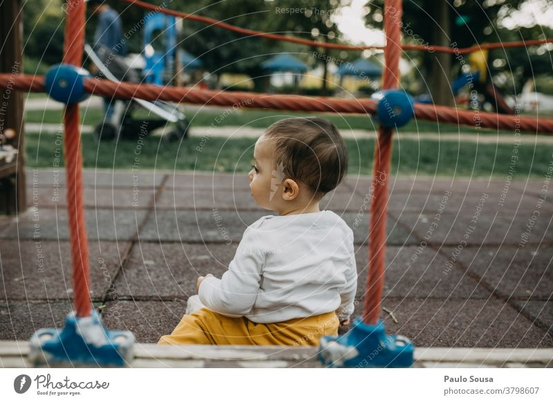 Toddler playing on the playground Playground Child Children's game Kindergarten Playing Infancy Exterior shot Day framed Copy Space top Happiness Human being