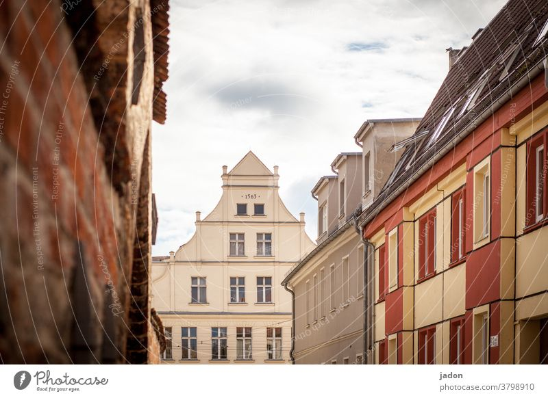 under the roofs of brb. Gable end pediment Facade House (Residential Structure) Exterior shot Deserted Wall (building) Building Window Architecture Sky Town Day