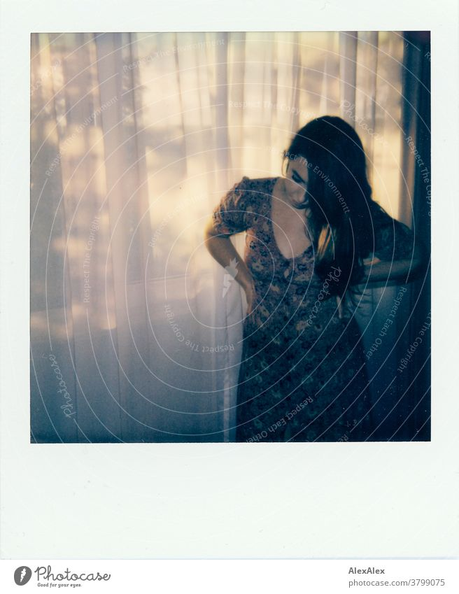 Polaroid- Portrait of a young woman in front of a hotel window portrait Woman pretty Near fit daintily Skin Face look Direct Long-haired Athletic youthful