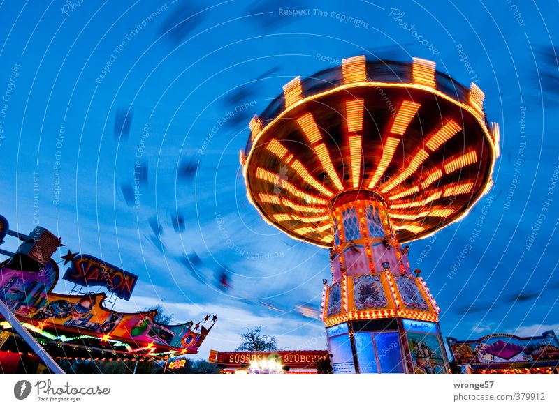 Flight through the evening Joy Fairs & Carnivals Rotate To swing Blue Multicoloured Leisure and hobbies Theme-park rides Carousel Gyroscope Chairoplane Lighting