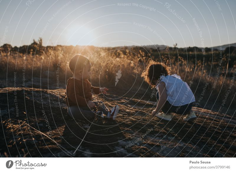 Brother and sister playing at Sunset Autumn Authentic Autumnal colours Brothers and sisters Family & Relations Colour photo Human being Child Infancy