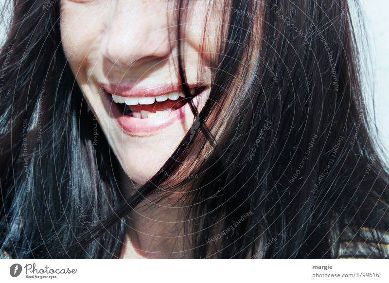 The laughing mouth of a woman without mouth guard and mask mouth opened Laughter Teeth Show your teeth Lips Nose long hairs Passion Face Close-up Young woman