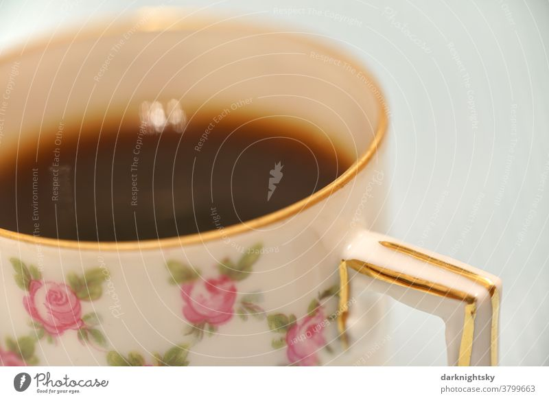 Mocha in a traditional mocha cup with gold rim and flower pattern of fine porcelain detail Coffee Pattern Close-up Espresso background Cup Beverage