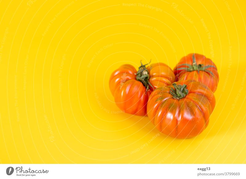 View of beautiful red heirloom tomatoes on yellow background abundance alimentation close-up colors colourful colours composition diversity eco ecology farming