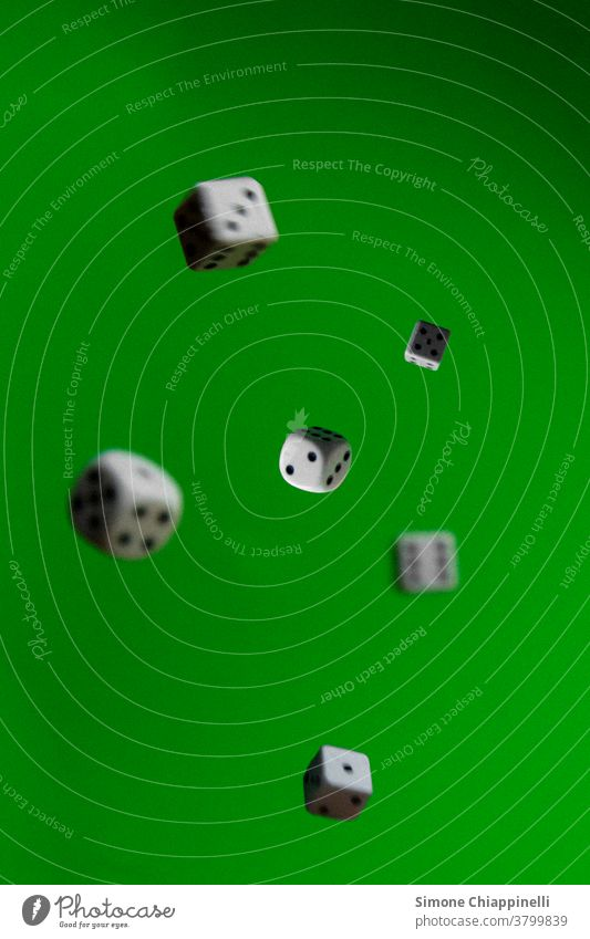 Throwing dice on green background Dice gambling Green Playing Throw dice Colour photo game Casino rolling dice Compulsive gambling