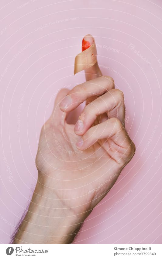 Bloody finger with patch on pink background Hand Pink Colour photo Red Neutral Background Hurt Wound Fingers Skin Pain Detail care Patch Health care health