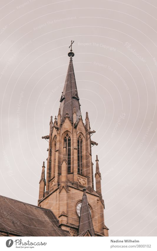 Church tower of the Herz Jesu church in Bad Kissingen in front of a thick cloud front Church spire Crucifix Religion and faith Building Clouds Christianity