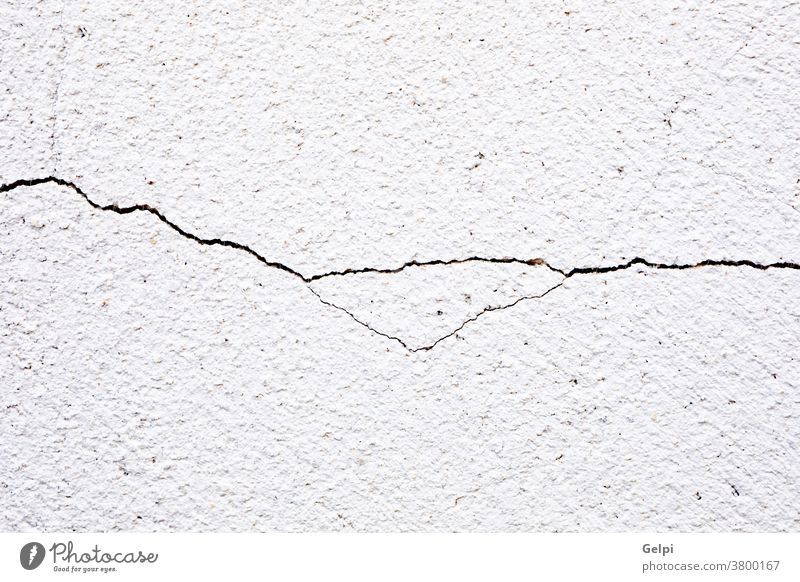 Close-up of a cracked background abstract old concrete wall paint pattern texture grunge white cement rough dirty design surface backdrop construction