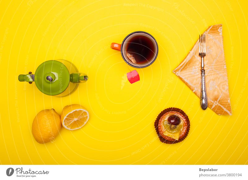 Top view of vintage teacup and cup with lemon and pastry on pink background flat lay top view breakfast green teapot beverage herbal set colorful boiling drink