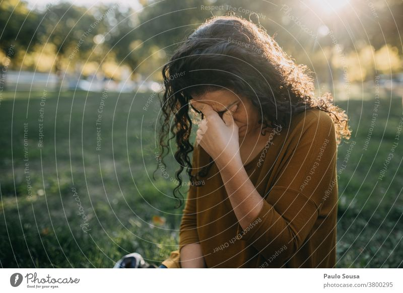 Woman with headache Headache people Caucasian migraine Exterior shot female person young woman Colour photo Adults caucasian depression Exhaustion tired