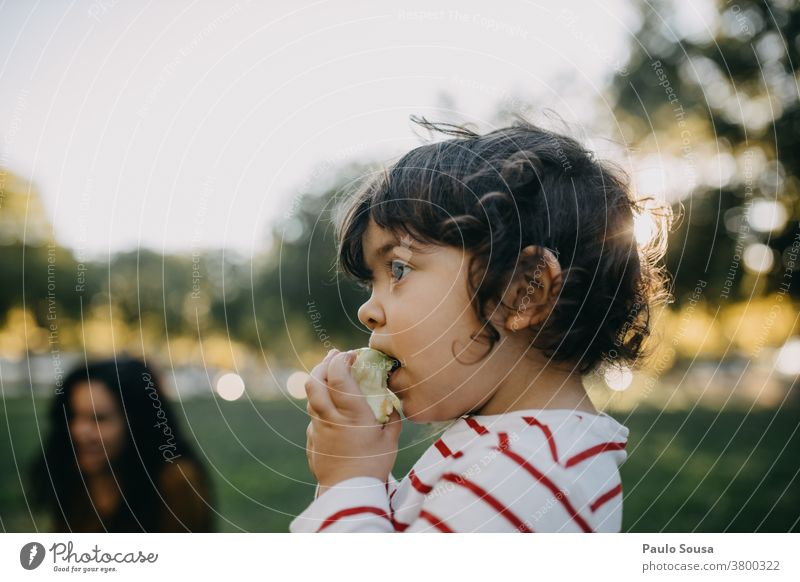 Child eating apple outdoors Caucasian 1 - 3 years people Healthy Eating Fruit Colour photo Infancy Food Nutrition Human being Toddler Multicoloured