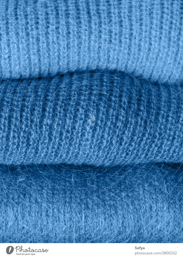 Pile of classic blue color woolen sweaters 2020 classical fashion yarn textile texture woman mohair background clothing phantom winter knit navy soft design