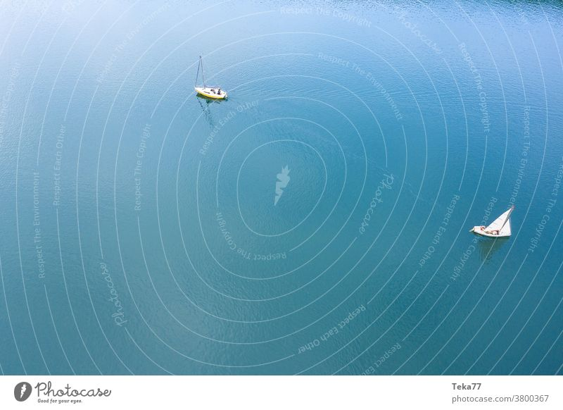 two sailing ships from above sports harbor sport boat harbor boats from above water white waves water sports swimming