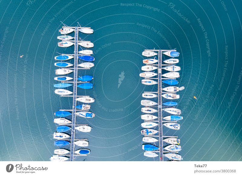 a sports harbor from above sport boat harbor sailing ships boats from above water white waves water sports swimming