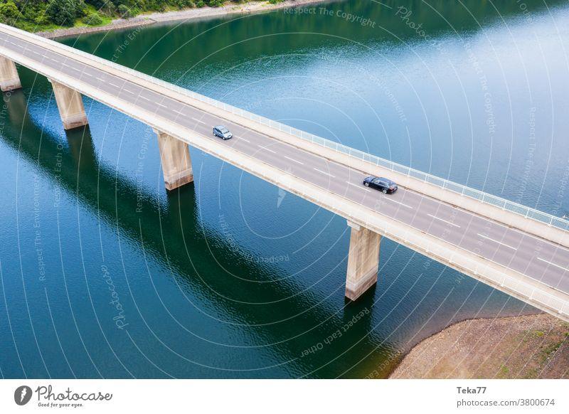 a car bridge over a river from above modern bridge car brigde transportation bridge water lake modern architecture cars trucks