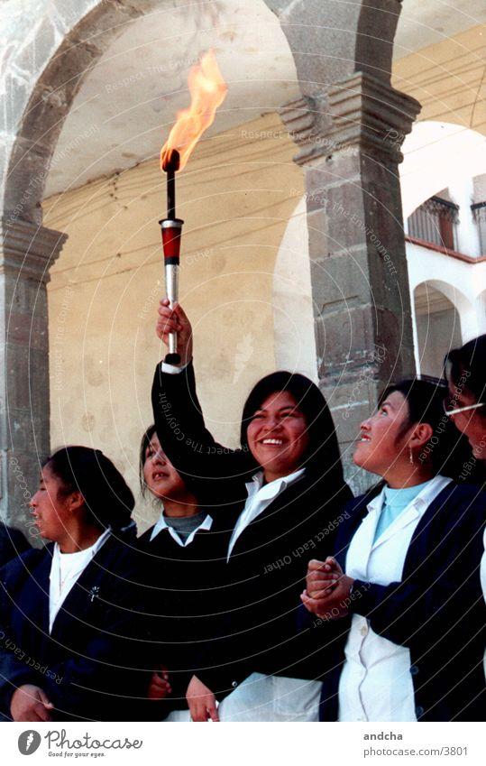 happy torchbearer Girl Schoolchild Uniform Human being Torch Fire Bolivia Laughter