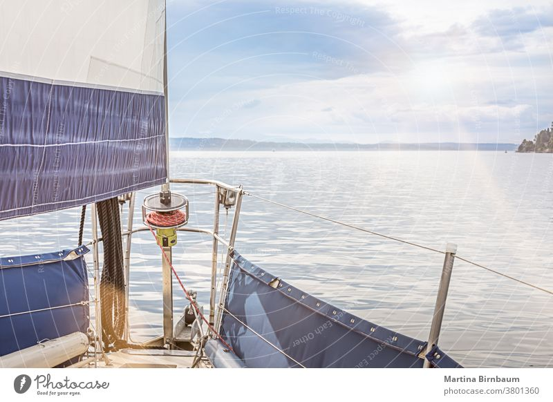 Sailing on a sailboat in the pacific ocean near Seattle, Washington sailing seattle journey cruise sport yacht sky yachting travel sunset blue horizon nautical